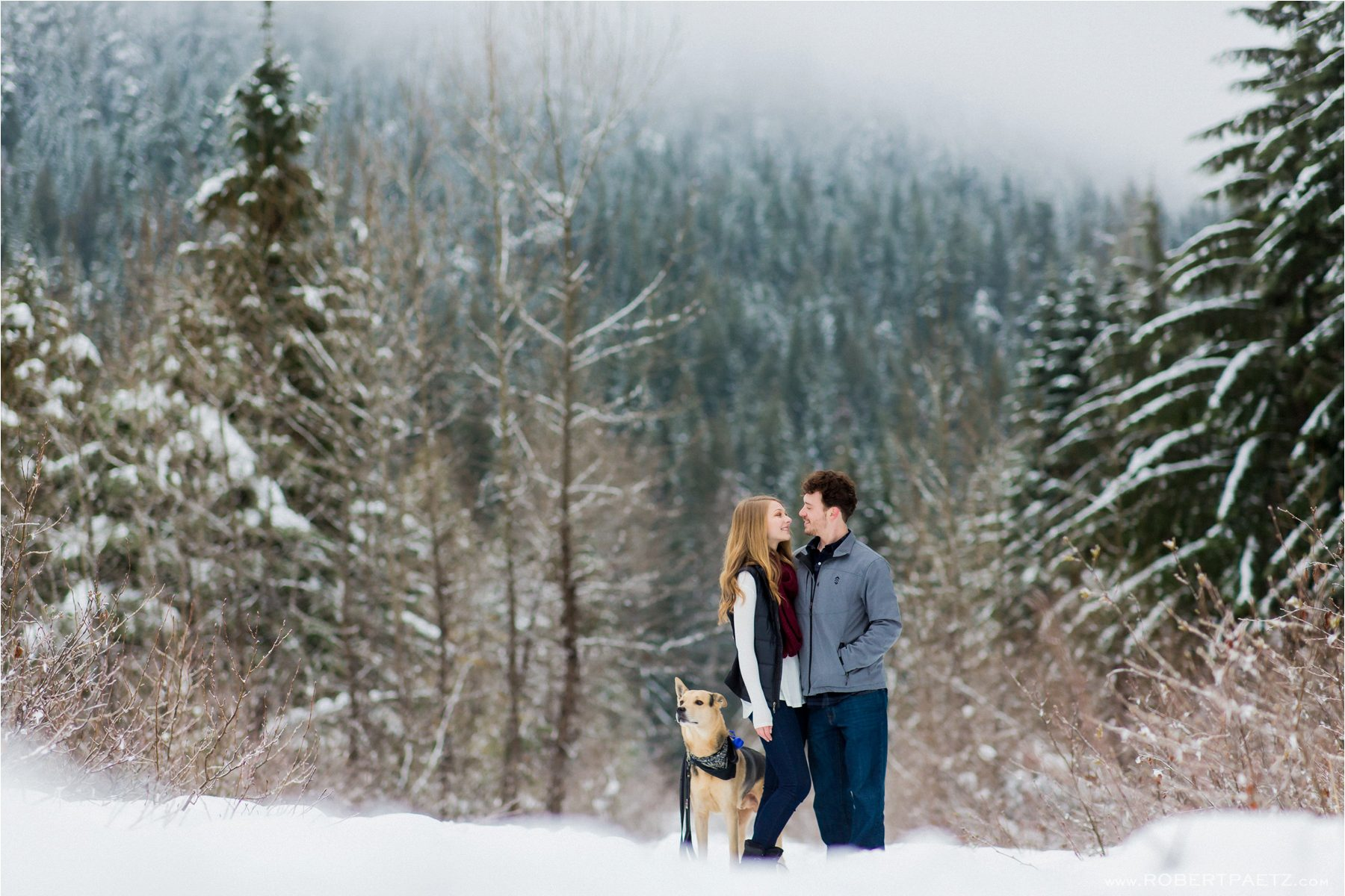A Snoqualmie engagement photography session in the snow outside of Seattle, Washington, photographed by the destination wedding photographer Robert Paetz.